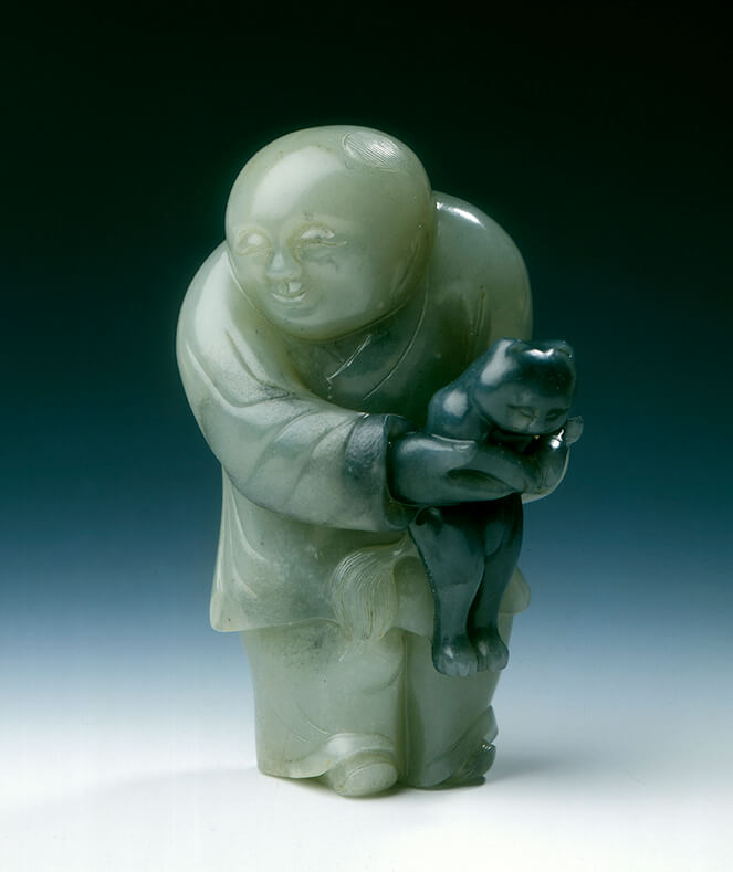 Jade chubby boy holding a black catEarly Ming dynasty (1368-1550) or earlier